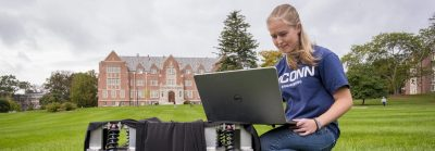 Emily Yale, one of the three inaugural students in our Master's of Engineering in Global Entrepreneurship program, with her autonomous robot at the Great Lawn on Oct. 7, 2019. (Sean Flynn/UConn Photo)